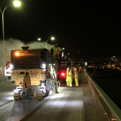 anrak crew with trucks working on a road