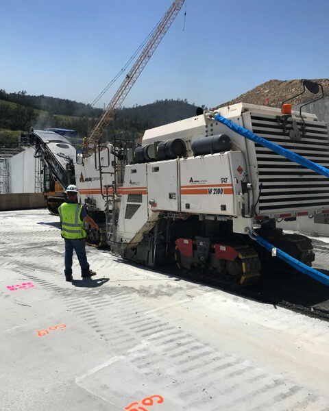 Anrak workers and trucks on the Oroville Dam Spillway