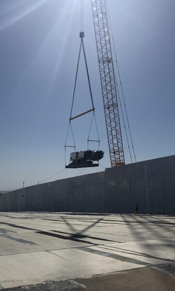 crane lifting heavy equipment in to the Oroville Dam Spillway